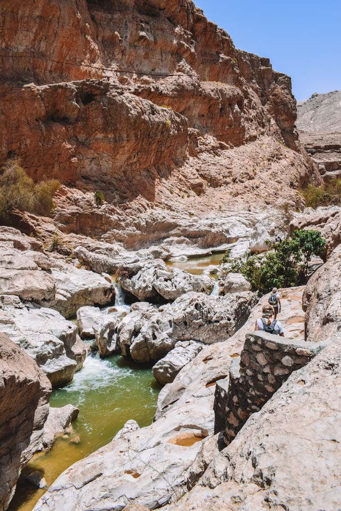 Hiking away from the main pool of Wadi Bani Khalid, upriver and deeper into the canyon