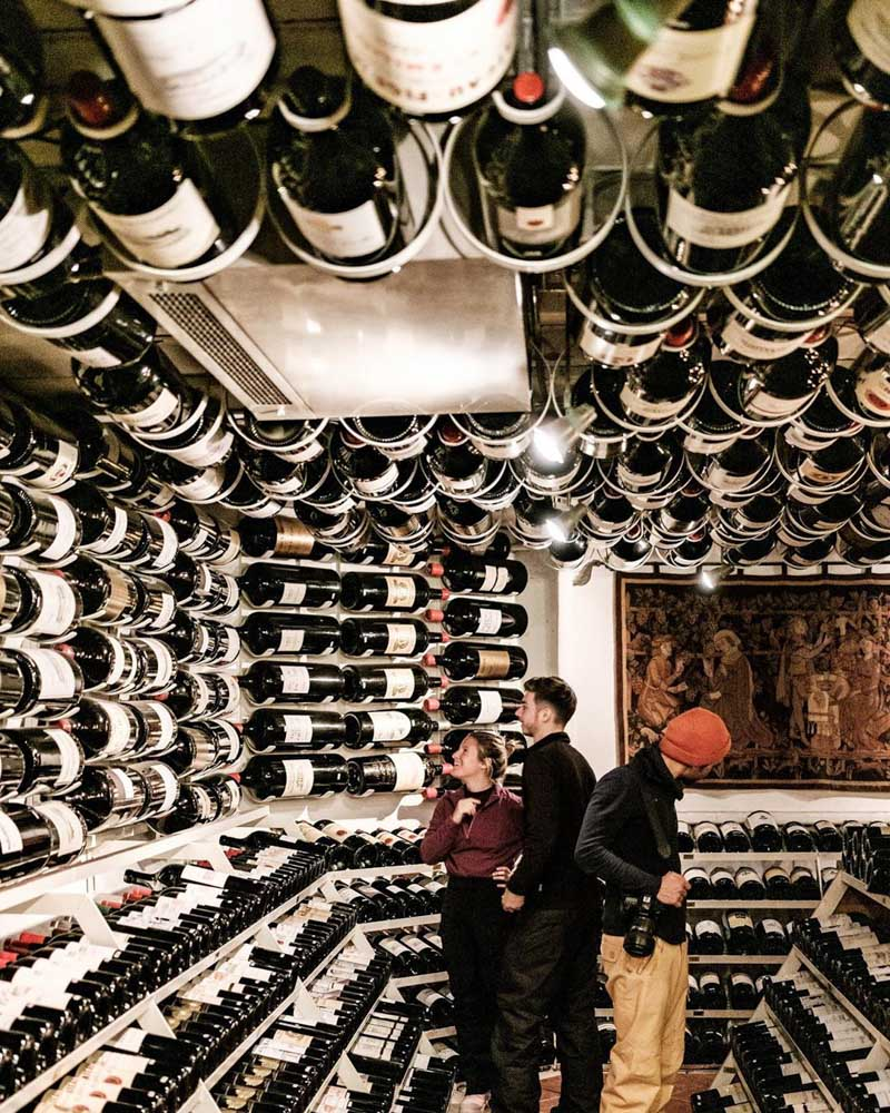 Exploring the wine cellar of Hospiz Alm in St Cristoph, photo by Best of the Alps