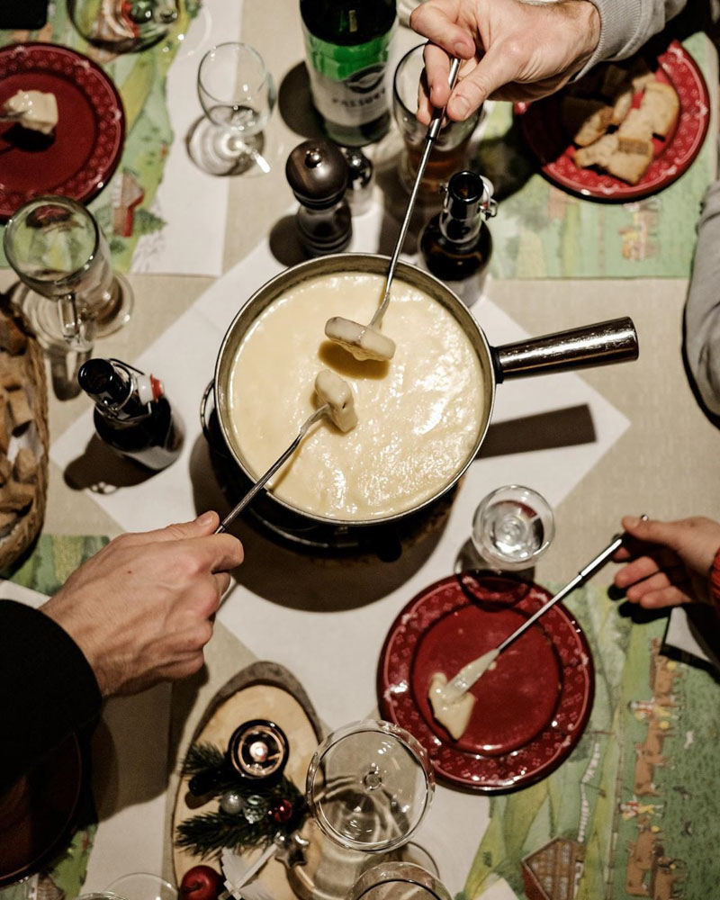 Cheese fondue at Restaurant Teufi! Photo by Ian Ehm @friendship.is / @bestofthealps