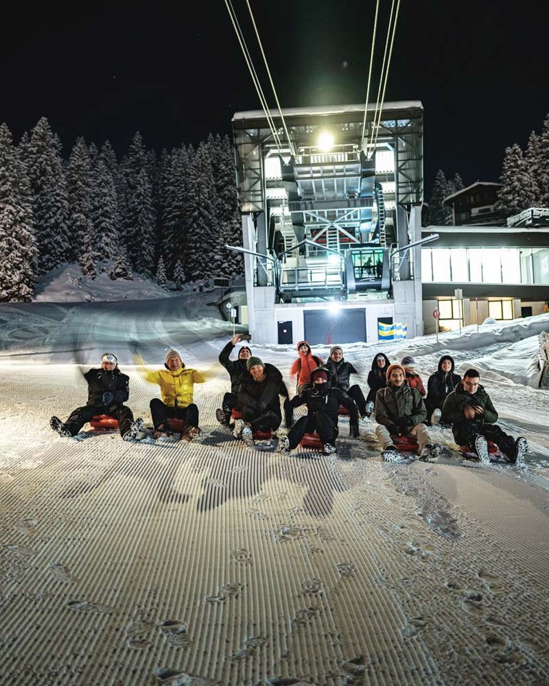 Going back to Lech from Oberlech with our toboggans!