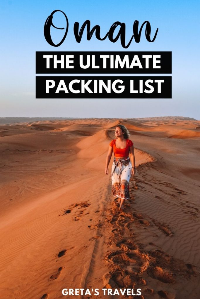 """Girl walking in the desert in Oman with text overlay saying """"Oman: the ultimate packing list"""""""