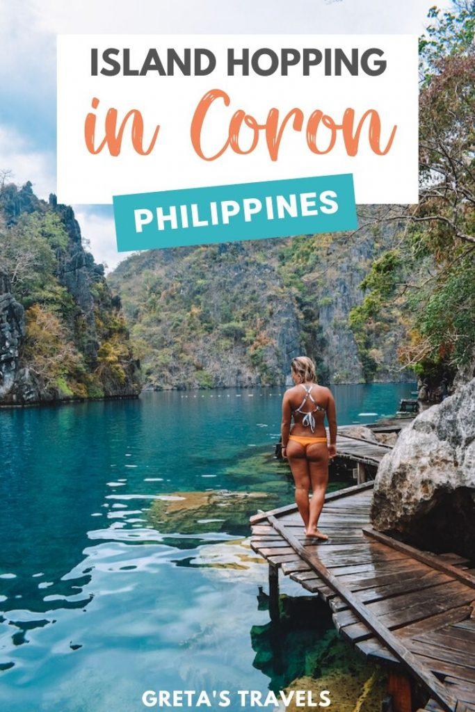 "Blonde girl in a bikini walking along the wooden boardwalk of Kayangan Lake with text overlay saying ""Island hopping in Coron, Philippines"""