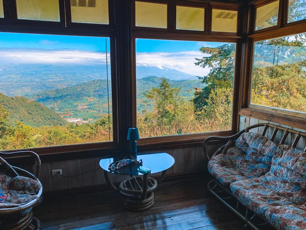 One of the lounge areas of our finca, with view over the valley of Orosi