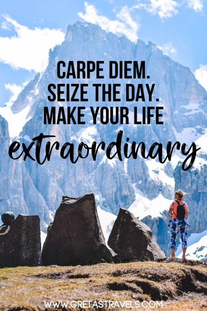 "Girl standing at the top of a mountain looking at the view with text overlay saying ""Carpe diem. Sieze the day. Make your life extraordinary"""