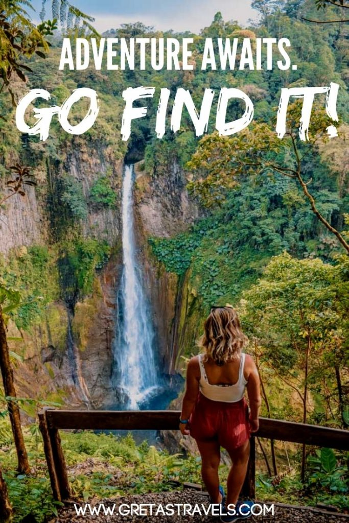 """Blonde girl looking at Catarata del Toro waterfall in Costa Rica with text overlay saying """"Adventure awaits, go find it!"""" - one of the best adventure quotes, perfect for travel Instagram captions"""