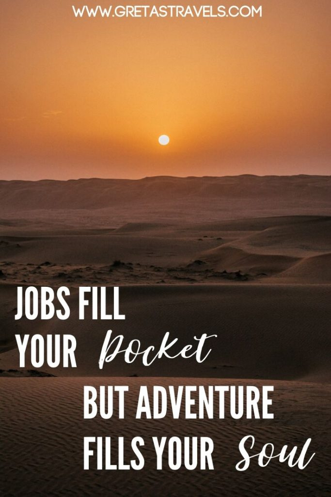 """Sunrise in the desert with text overlay saying """"Jobs fill your pocket but adventure fills your soul"""" - one of the most inspirational adventure quotes"""