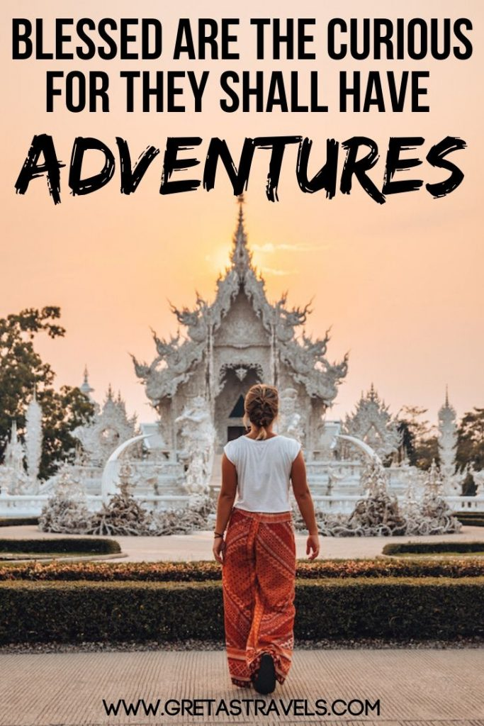 "Blonde girl walking in front of the White Temple in Chiang Rai, Thailand, with text overlay saying ""Blessed are the curious for they shall have adventures"" - one of the best travel quotes in my opinion"