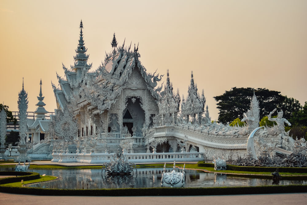 Sunset at Wat Rong Khun, the famous White Temple in Chiang Rai