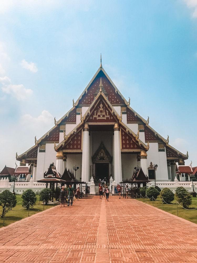 The golden Buddha inside Wat Phra Mongkhon Bophit from the outside