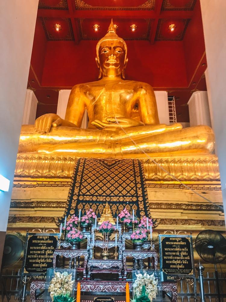 The golden Buddha inside Wat Phra Mongkhon Bophit