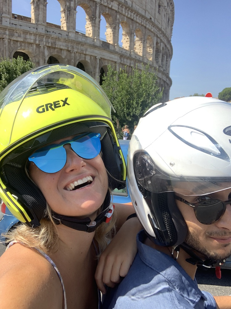 Scootering around Rome - that's the Colosseum behind us!