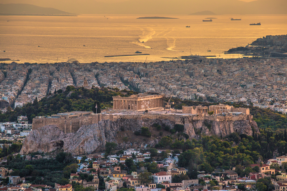 Aerial view of the Acropolis and Athens at sunset - Photo by Vagelis Pikoulas on Scopio