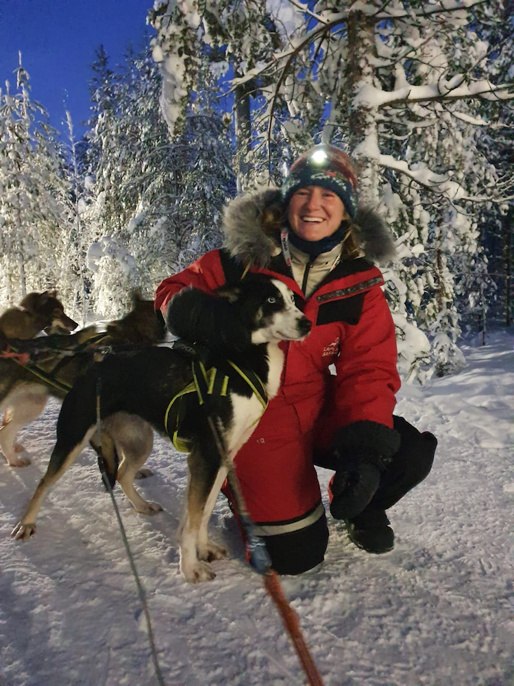 Getting to know my sledding tour husky dogs in full Lapland winter gear