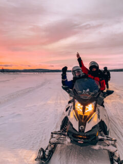 Doing a snowmobile tour in Inari, Lapland