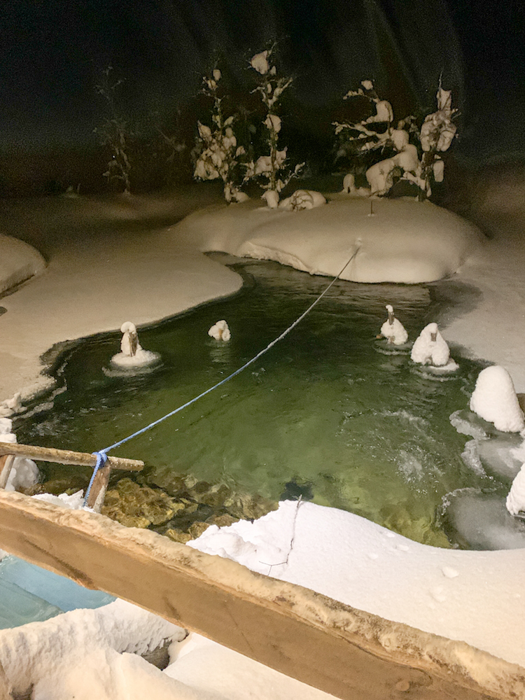 An outdoors ice bath in Lapland you can swim in after doing a sauna