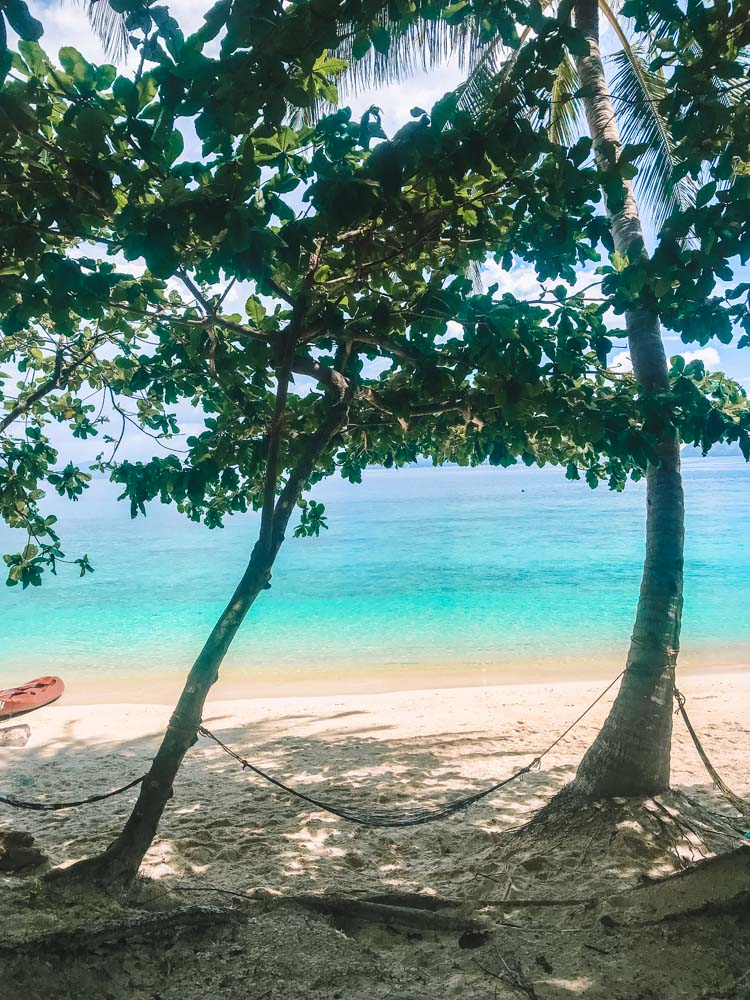 The hammock spot on Papaya Beach, which you can reach by kayak in El Nido