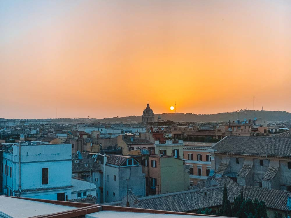 Sunset over the rooftops of Rome from Up Sunset Bar