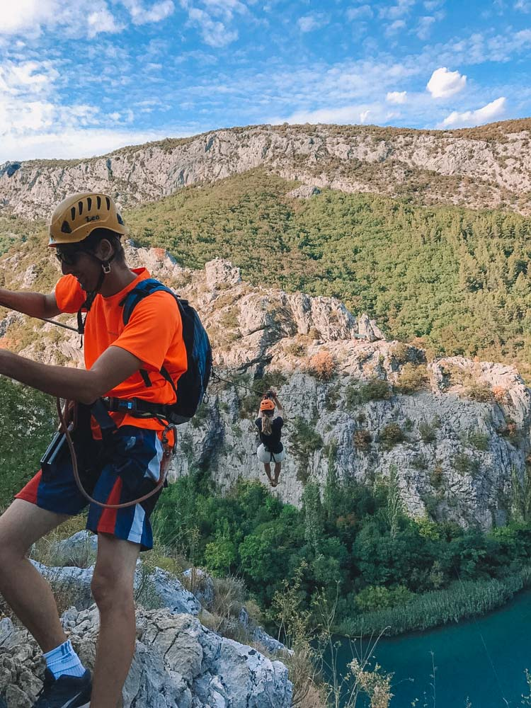Our zipline tour guide and my friend Laura ziplining across the Cetina Canyon, Croatia
