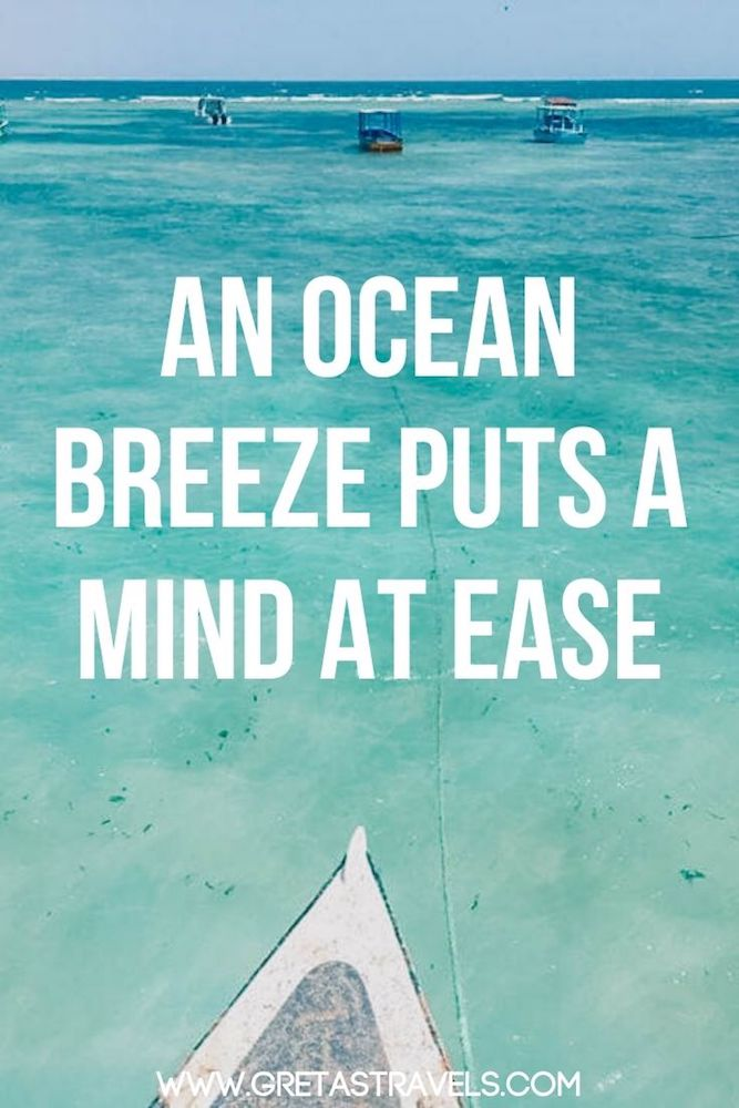 """Photo of the beach and sea in Malindi with text overlay saying """"An ocean breeze puts a mind at ease"""" - one of my favourite beach quotes!"""