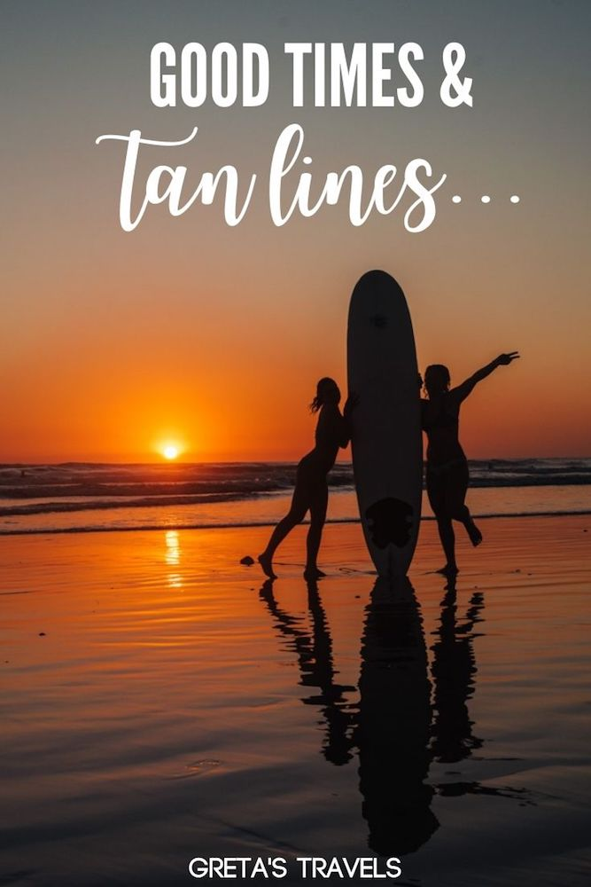 """Photo of two girls holding a surf board on Santa Teresa Beach at sunset with text overlay saying """"Good times and tan lines"""""""