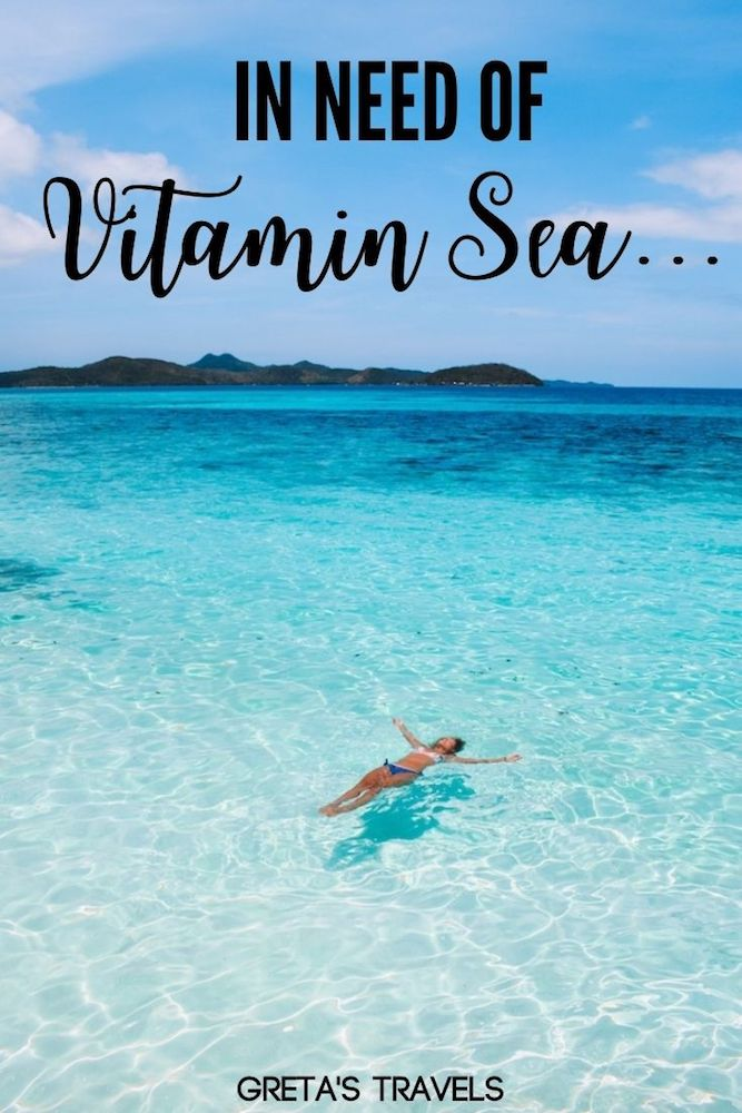 """Photo of a girl floating in the turquoise water of Malcapuya Island with text overlay saying """"In need of vitamin sea"""" - a perfect Instagram caption for travel beach photos"""