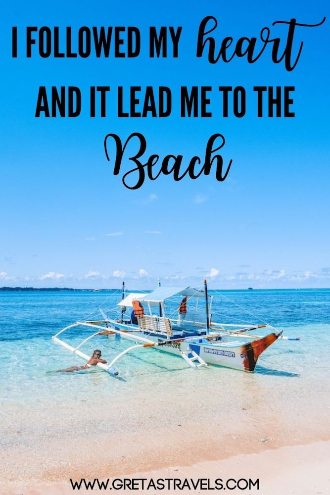 """Photo of a girl by a traditional Filipino boat in Siargao Island with text overlay saying """"I followed my heart and it lead me to the beach"""" (one of my favourite beach quotes!)"""
