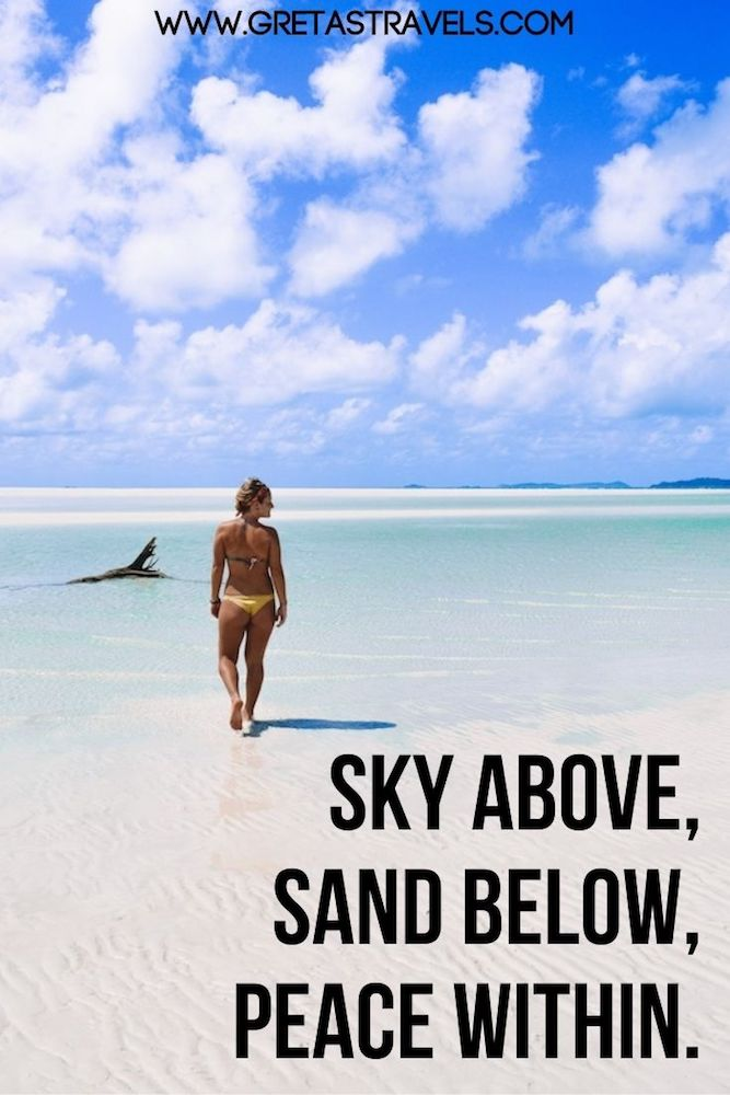 """Photo of a girl walking Whitehaven Beach in Australia with text overlay saying """"Sky above, sand below, peace within"""" - a beautiful travel quote for Instagram beach captions"""