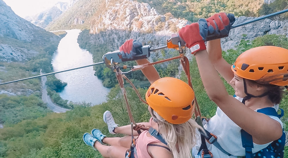 Me and my friend Francesca zip-lining over the Cetina Canyon in Croatia