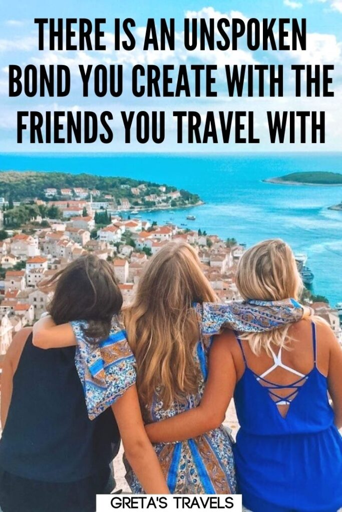 """Photo of three girls hugging each other and enjoying the view over the harbour of Hvar in Croatia with text overlay saying """"There is an unspoken bond you create with the friends you travel with."""" - one of the best quotes about travelling with your mates"""