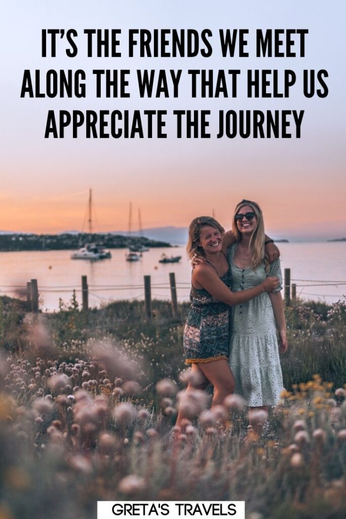 """Photo of two girls hugging on the beach at sunset with text overlay saying """"It's the friends we meet along the way that helps us appreciate the journey."""" - one of my favourite travel with friends quotes"""