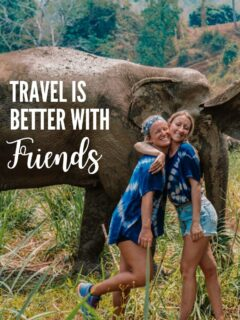 Photo of two girls hugging next to some elephants in Thailand with text overlay saying