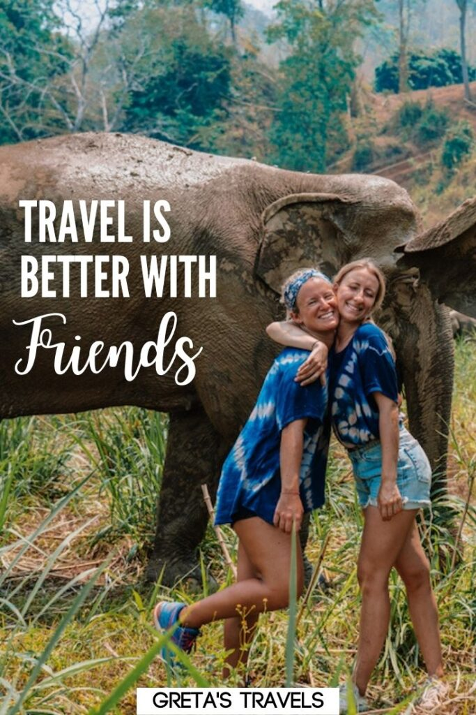 """Photo of two girls hugging next to some elephants in Thailand with text overlay saying """"Travel is better with friends"""""""