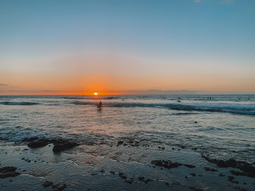 Watching the sunset over El Medio surf spot from Playa de las Americas, Tenerife