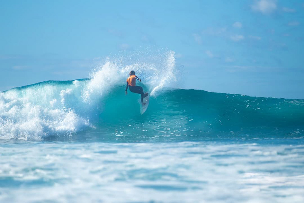 Alejandro Calle Rattia, one of the surf instructors at Surf Life Tenerife, surfing in Fitenia