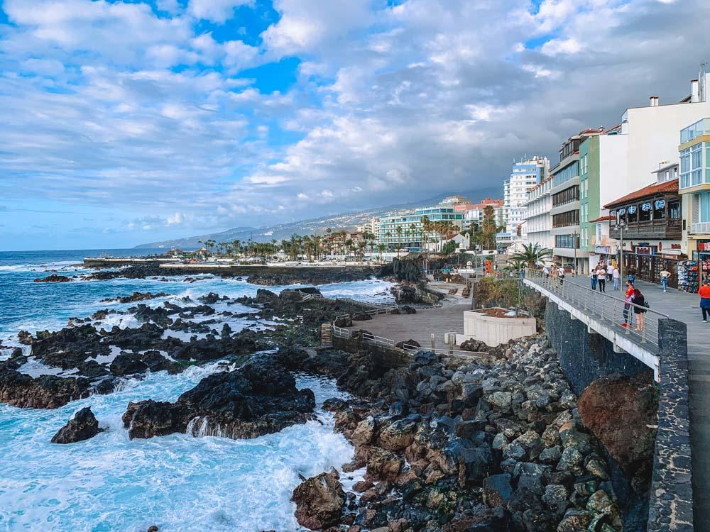 Walking along the seafront of Puerto de la Cruz in Tenerife