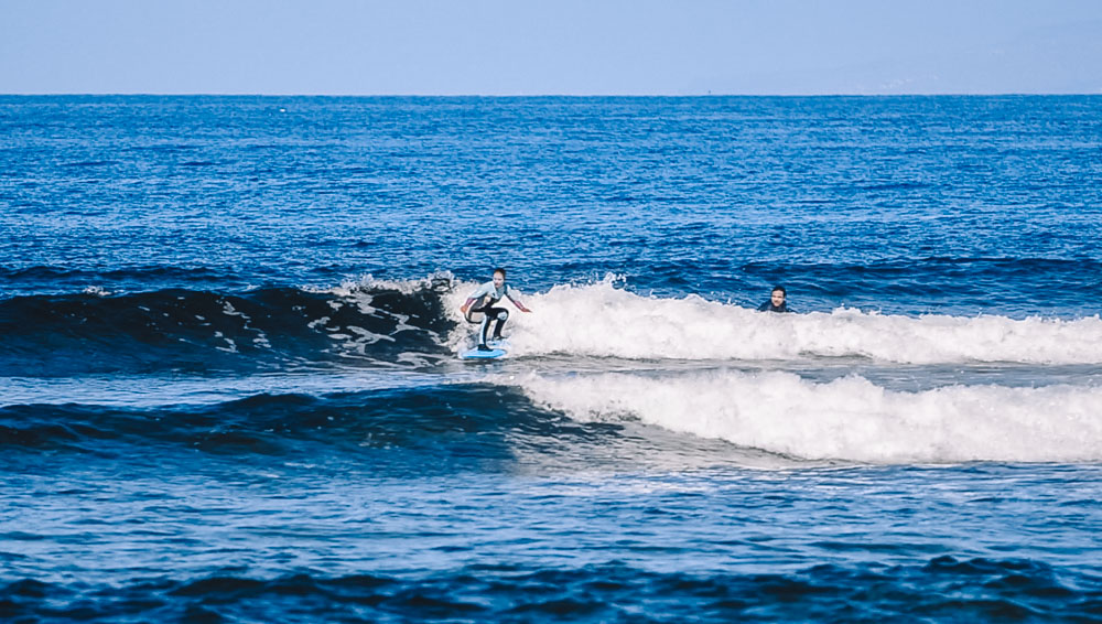 Me surfing at Jeffreys - catching some green waves after two months of practice!