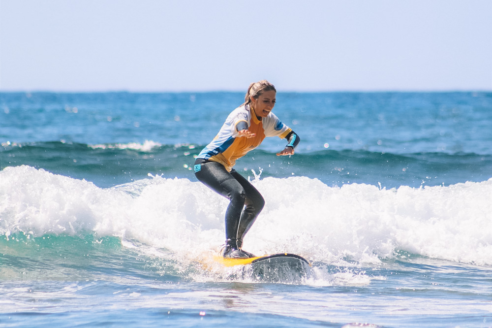 My friend Diana Bancale (In Viaggio Da Sola) surfing in Fitenia during a class with Surf Life Tenerife