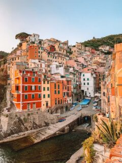 Sunset over the perched colourful houses of Riomaggiore in Cinque Terre, Italy