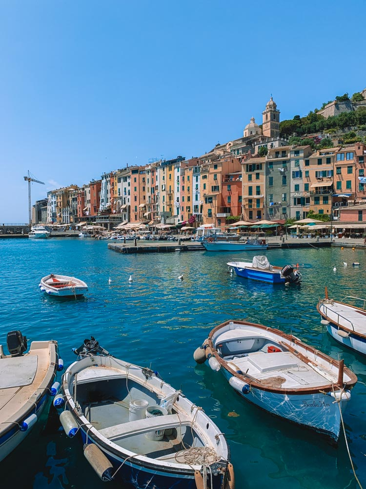 The harbour and colourful houses of Porto Venere in Italy - a perfect place to stay in Cinque Terre for those looking for a hidden gem