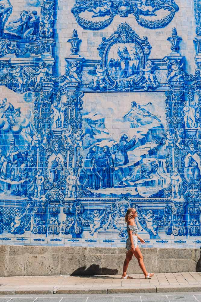 Admiring the famous azulejos facade of the Chapel of Souls in Porto