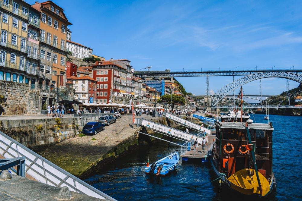 Walking along Cais da Ribeira in Porto, Portugal