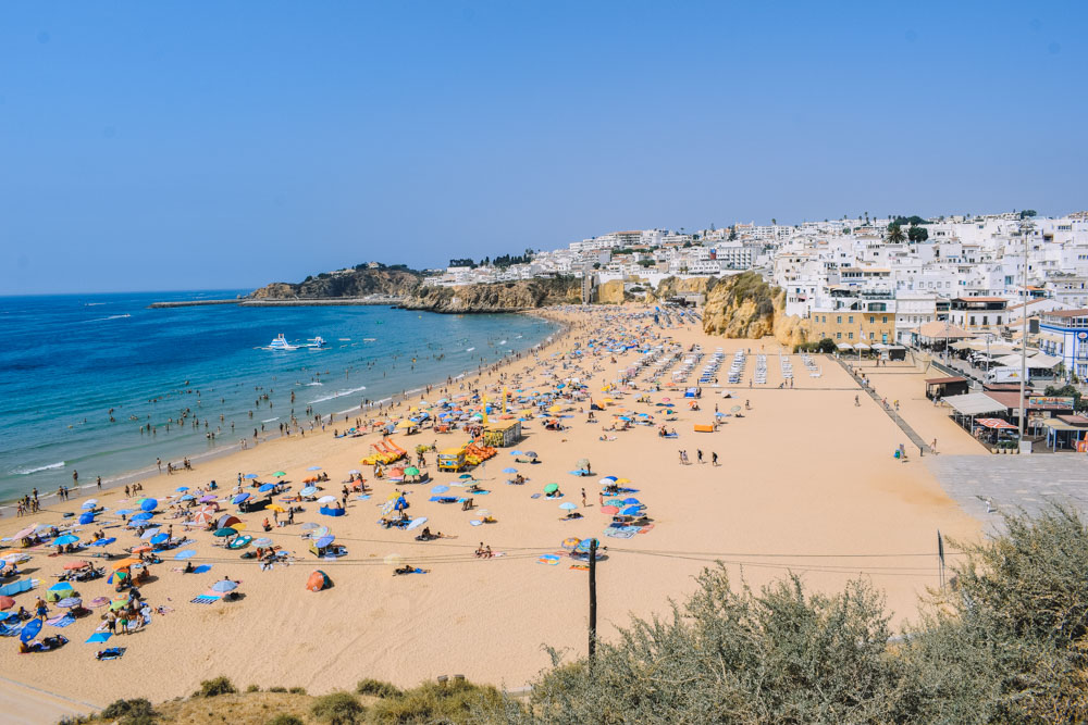 Praia dos Pescadores in front of Albufeira city centre, with Albufeira old town behind it