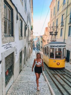 Walking next to the famous Elevador da Bica in Lisbon, Portugal