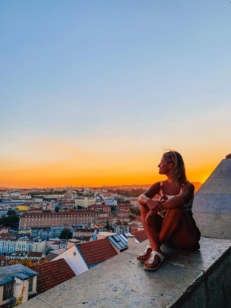 Enjoying the sunset over Lisbon from Miradouro da Senhora do Monte