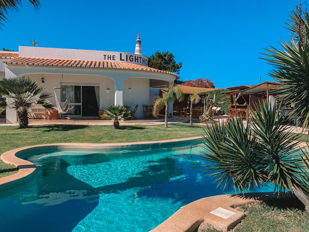 The pool and garden of The Lighthouse Hostel in Sagres